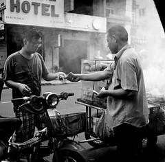Money Exchange (mteckes) Tags: hasselblad 500c bw kodak kodaktrix trix ziessplanar80mm28 zeiss saigon hochiminhcity vietnam film blackandwhite monochrome