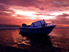 The Lonely Boat (Xshfaq) Tags: boat lonely sea red water sky twilight seabeach longestseabeach picofthedays travel vacation summer nature naturalbeauty ashfaqislam photography coxsbazar bangladesh