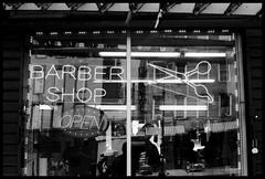 Barber Shop (brownbeatle) Tags: blackandwhite analog film kodaktrix400 canoneosrebel canonef50mmf18 barber shop street reflection
