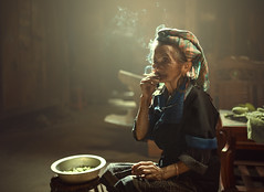 Alone woman smoking time (Sutipond Somnam) Tags: vietnamese laos hmong smoke blowing girl puff old horizontal cigarette one black browneyes woman brunette pretty profile white headandshoulders blackbackground thinking vietnam hand serious blouse life alone womansmoking vietnamwoman grandmother lifestyle people sad mohter