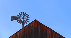 Barn Peak (studioferullo) Tags: abstract architecture art beauty building buildings barn bluesky bright colorful brown blue contrast country decay design detail diagonal farm ranch high historic light line lines metal minimalism old outdoor outdoors outside perspective pattern pretty round rustic scene sky skyline study sunny sunlight sunshine texture tone tones weathered wood windmill empireranch sonoita arizona wall peak aeromotor