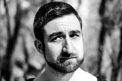 My Skepitcal Muffin (LauraJSwindle) Tags: branches man armenian guy beard skepitcal expressions facialexpressions monochrome 85mm macrolens nikond7100 ny newyork outdoors blackandwhite hoytfarm longisland male boyfriend wantagh usa