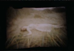 pinhole shoot (Ella Jackson) Tags: blue summer portrait sun white black cold beach garden person photography scary sand warm pin hole ghost warmth ivy down pinhole haunting lying ghostly eery llagrace