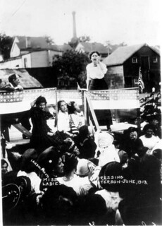 From flickr.com/photos/8337233@N06/7088650663/: Elizabeth Gurley Flynn addresses striking silk workers in Paterson, New Jersey, June 1913.