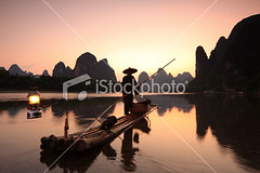 Fishermen-on-li-river (MPBHAIBO) Tags: china morning cloud mist mountain reflection bird water fog sunrise river landscape dawn liriver fishing fisherman asia dusk guilin yangshuo hill cormorant   relaxation  cloudscape stormcloud cumulonimbus  chineseculture  xingping  ruralscene fishingindustry  karstformation chineseethnicity woodenraft  guangxiregion