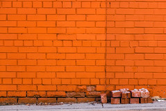 Hello Walls (Kat N.L.M.) Tags: city urban orange toronto ontario canada brick horizontal wall outside outdoors vibrant bricks leg nobody stack sidewalk simplicity simple walkingby stackofbricks pileofbricks