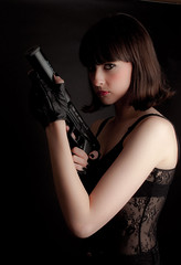 Silencer girl (Floyd Rosen) Tags: gloves pistol silencer hitwoman