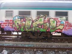 bright green eyes (en-ri) Tags: train writing torino graffiti crew lingua gelato mano 135 viola krazy rosso tek occhio cerotto fw lilla cono rese mattoni denti tvk cappellino uao rwrz kwz