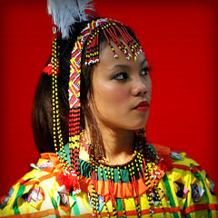 Portrait of an Asian Girl in a Colorful Traditional Costume  -:- 0373 (buddhadog) Tags: asianfemale portrait red 500x500 colorful beads costume 100vu 500vu 1000vu challengeyouwinner mm108 candidphotoshot gamewin g2haiku nikonflickraward 3wins 5000 ccc 35faves
