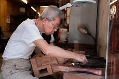 Wood Sculpter in Tainan (e.w. cordon) Tags: asia taiwan tainan work sculptor wood artisan man men travel ewcordon shop worldtravel
