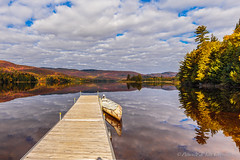 Invitation to freedom (P & Y Photography) Tags: nature landscape lake water boat nativeamerican americanindian raft lacmonroe monroelake parcnationaldumonttremblant laurentides laurentians northamerica quebec canada fall colors fallcolors reflection sky clouds pier dock trees autumn serenity wildnerness canon 6d 1635 canoe outdoors adventure colorful orange red yellow green travel