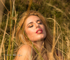 Basking in the setting sun (trethurffe2001) Tags: cheshire england eyesshut face fantasy fashion female longgrass model moors peakdistrict peakdistrictnationalpark photographicmodel settingsun sun sunshine people portrait outdoor