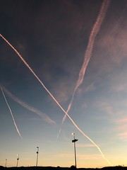 Pamplona (Barásoain) again in morning - the 'rose sky triangle' become a 'rose sky cross'. (arwed.kubisch1) Tags: rose espana spain spanien pamplona blue sky blau himmel rosa exhaust fumes abgase barasoain barásoain acciona morning morgen iruñea iruña navarre navarra iphone