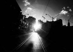 Queen St (m.dahlke) Tags: pentax spotmatic film jch streetpan fisheye fish eye bw black white blackandwhite monochrome toronto ontario canada queen street sun streetcar tracks silhouette city contrast