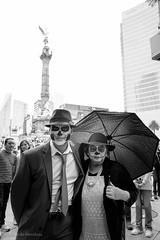 EMP_20161023_096.jpg (Ojo de Piedra) Tags: culture xseries tradition reforma catrinas xt10 afternoon people umbrella blackwhite hat faces portrait fujifilm mexicocity mexico mex