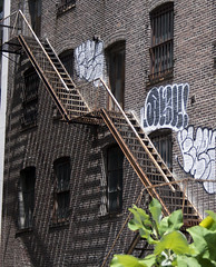 299 10th Avenue - apartments - 5 floors built 1930 (wmpe2000) Tags: 2016 ct summer daytrip nyc highline highlinepark building architecture fireescape stairs lines ladder bricks graffiti