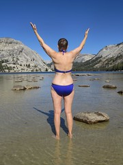 Nature Lover in Yosemite (moonjazz) Tags: joy nature woman yosemite mountains swimming blue sky swimsuit wading sensual lake queen wonder delebration appreciation wow bikini pretty arms up sexy she being high life wild wilderness female love emotions earth california country sunshine beautiful bliss alleluia stong wise stone people photography moonjazz happy