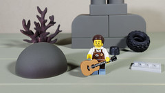 The cities are in such a mess that Larry is going to write a Blues song about it. (Busted.Knuckles) Tags: home toys lego miniature larry olympusomdm10mkii dxoopticspro11