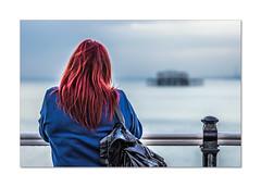 Texting on the pier (hehaden2) Tags: woman back redhair pier palacepier brightonpier sea westpier brighton sussex