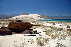Tank and cliffs (indomitablemachine) Tags: cliffs coast sand socotra tank yemen hadhramautgovernorate ye