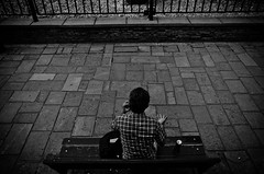 _DSC9892 (stimpsonjake) Tags: nikoncoolpixa 185mm streetphotography bucharest romania city candid blackandwhite bw monochrome phonecall man bench hand overhead