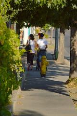 The lonely sidewalks of Merced (radargeek) Tags: merced ca california hydrant couple stroller tattoo
