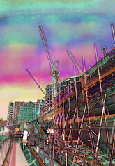 brutified (dick_pountain) Tags: shockofthenew scaffolding building cranes canal pontoon runner mashup