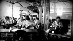 Sunday afternoon at Gino's (jaap spiering | photographer) Tags: jaapspiering jaapspieringphotographer jaapspieringfotografie blackandwhite monochrome zwartwit bw noiretblanc streetphotography street people mens mensen couple man men woman vrouw women vrouwen femmes femme ginos fremantle australia travel coffee koffie coffeebar coffeeshop keuken koken cook kok food eten lekker restaurant brasserie bar lunchroom gx8