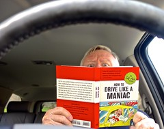Doing a Little Studying Before I Hit the Road (ricko) Tags: book car reading studying steeringwheel werehere selfportrait 337366 2016