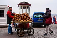Farzana, the happy photographer-7035.jpg (coughlan_e) Tags: turkey photography dock documentary istanbul selling seller karakoy simit farzana phototrek
