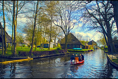 Whispering~Explored 17042012[Front Page] (Prasanna Gururajan) Tags: trees people house holland reflection tree home water netherlands garden countryside boat town canal whisper branch silent village slow ride branches peaceful calm driver motor tone giethoorn punters whisperboat mygearandme mygearandmepremium mygearandmebronze