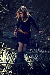 Mistress Fogg (Red 5 Photography) Tags: bridge trees nature fashion creek forest river outdoors skull belt woods stream boots branches windy jewelry tribal brunette lookingdown medicinewoman mistress fogg steampunk blackdress brownhair hairblowing furryboots wildwoman skullnecklace stickbridge foggcouture