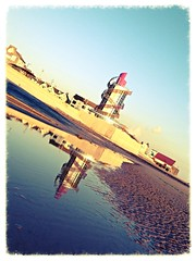 The beacon reflected (sonofadkin) Tags: blue sky reflection tower beach water pier seaside sand beacon uploaded:by=flickrmobile flickriosapp:filter=chameleon chameleonfilter