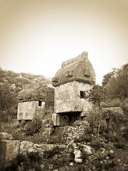 Lycian tombs in Kayaköy (VillaRhapsody) Tags: old summer bw stone sepia rural ancient village antique monotone graves sarcophagus tombs lycian kayaköy preroman