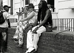 The Wall (Becky Frances) Tags: street city carnival summer urban blackandwhite london candid streetphotography nottinghill westlondon 2013 pollyblue