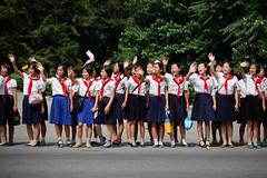 Cheering schoolgirls (Lil [Kristen Elsby]) Tags: girls children uniform asia korea parade editorial dailylife waving schoolgirls cheering schooluniform northkorea shouting reportage koreanwar armistice pyongyang eastasia dprk travelphotography topv33333 canon70200f28l canon7020028l democraticpeoplesrepublicofkorea chosnminjujuiinminkonghwaguk victorydayparade dprofkorea canon5dmarkii