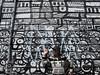 she fits right in! Kensington Market,  Toronto (marly.jane) Tags: portrait blackandwhite woman streetart toronto canada art girl canon person graffiti market kensington camoflauge rds g11