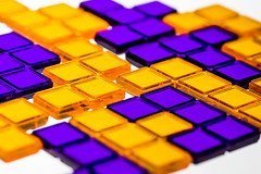 Blokus II (Tria-media_Sven) Tags: macromondays backlit backlight blokus game gems blocks tetris orange purple violet yellow underlit