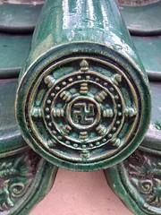 Glazed roof tile detail at local temple (nil Jethwa) Tags: swastika green glazed roof tile buddist temple closeup peace