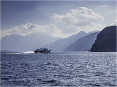 Hydrofoil (Luc V. de Zeeuw) Tags: bluesky clouds comolake hydrofoil mountain speed water bellagio lombardia italy