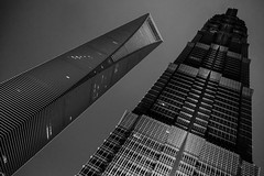 Shanghai World Financial Tower + Jin Mao Tower (imageneer) Tags: fujifilm xe2 china asia jinmao bottleopener xf1855mm building bw tower worldfinancialcenter swfc architecture shanghai skyscrapper