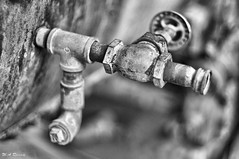Spigot of time (wesleyramsey) Tags: rust rustic old antique blackandwhite monochrome bw metal spigot water faucet sony nex5t supertakumar50mm takumar wideopen abstract