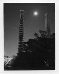 INSTANT FILM- SYDENHAM BRICKWORKS (Eva Flaskas) Tags: chimney bw moon white black tree history film st night plane polaroid star long exposure fuji flight sydney trail pack instant historical brickworks peters sydenham 195