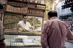 Buying Baklava (roomman) Tags: portrait people food man guy face shop turkey store drink istanbul eat buy turkish bargain baklava haris 2013