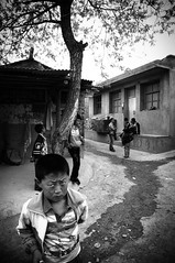 hello there, Gansu, China (Ordinary_Folk) Tags: poverty china yellow rural children village child sony voigtlander 14 mc inside 40mm journalism gansu cause arup nex 5n wzq classicphotojournalism