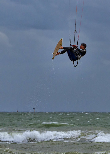 Kite surfer suspended in the air