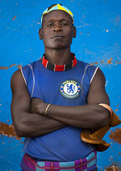 Hamer Tribe Man With A Chelsea Football Shirt, Turmi, Omo Valley, Ethiopia (Eric Lafforgue) Tags: africa portrait people color men vertical outside outdoors photography necklace football colorful day serious outdoor muscular african culture jewelry skirt tribal omovalley tradition ethiopia tribe pastoral ethnic hairstyle bizarre bana hamar oneperson hamer onepeople frontview lifestyles hornofafrica ethnology omo banna eastafrica youthculture brightcolour headrest bluebackground tribesman onepersononly realpeople footballshirt colorimage blackskin lookingatcamera onlymen onemanonly waistup keyafer colourimage africanethnicity 1people pastoralist onemidadultmanonly keyafar snnpr chelseashirt 2024years southernnationsnationalitiesandpeoplesregion modernityandtradition sleeveshirt ethiopianethnicity omo137139