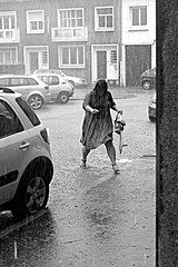 it's rainin' again (Broady - Salford art and photography) Tags: street urban woman storm france wet rain umbrella mono raining pouring brolly calais soaked brolley broady stephenbroadhurst switz2013b