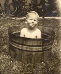 Baby in a Barrel, 1929 (ozfan22) Tags: baby water barrel 1929