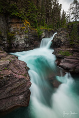 Glacial Waters (jeremyjonkman) Tags: park trees red tree green water beautiful saint rock forest river landscape flow waterfall moss montana rocks long exposure turquoise mary relaxing peaceful canyon falls glacier national flowing heavy mossy